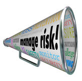 Manage Risk Bullhorn Megaphone Limit Loss Liability Compliance. Manage Risk words on a bullhorn and megaphone along with words of advice for loss prevention Royalty Free Stock Images