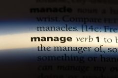 Manage. Word in a dictionary.  concept royalty free stock photo