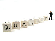 Manage your quality. A manager behind the word quality stock images