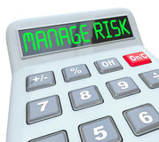 Manage Your Risk Calculator Financial Compliance Money Audit. Manage Risk words on a calculator to illustrate financial compliance and money auditing in Stock Photography