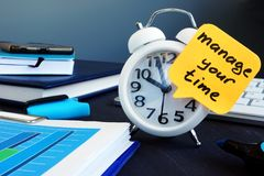 Manage your time. Alarm clock and memo stick. Manage your time concept. Alarm clock and memo stick stock images