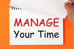 Manage Your Time. Written on notebook. Hand turn page stock images