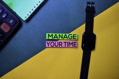 Manage Your Time text on top view color table background stock photos