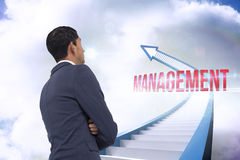 Management against red staircase arrow pointing up against sky Royalty Free Stock Photo