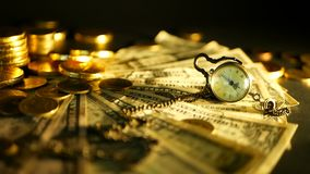 Management efficiency. Stacks of golden coins dollar notes on black background. Success of finance business, investment. Financial ideas concepts. Rotating stock video footage