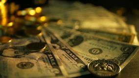 Management efficiency. Stacks of golden coins dollar notes on black background. Success of finance business, investment. Management efficiency. Stacks of golden stock video footage
