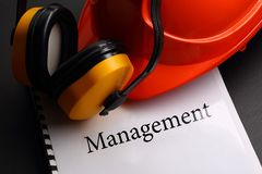 Management with helmet Royalty Free Stock Photo