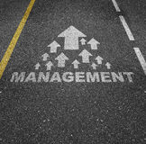 Management illustrated on pavement Stock Photos