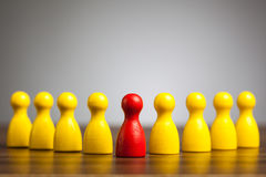 Management leader concept with toy pawn figures Stock Images