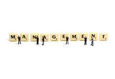 Management - Letters being surrounded by miniature Royalty Free Stock Images