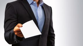 Management submits an envelope to employees.  royalty free stock photography