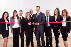 Management about to cut the red ribbon Royalty Free Stock Photos
