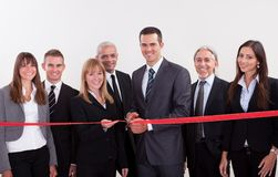 Management about to cut the red ribbon Stock Photos