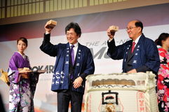Management toasting sake at Mazda CX-5 launch Royalty Free Stock Photos