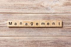 Management word written on wood block. management text on table, concept stock image