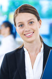 Manager. Portrait of young pretty woman in business environment Royalty Free Stock Image