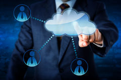 Manager Accessing Human Resources Via The Cloud. Torso of a male business manager accessing human resources by touch via cloud. Three white collar worker icons royalty free stock images