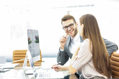 Manager and accountant are sitting and discussing financial charts with profits and expenditures of the company Stock Photo