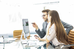 Manager and accountant are sitting and discussing financial charts with profits and expenditures of the company Royalty Free Stock Photo