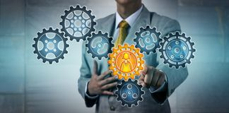 Manager Activating Female Worker In Gear Train stock photography
