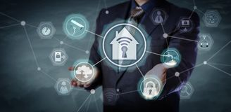 Manager Activating Security And Home Automation Royalty Free Stock Image