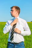 Manager adjusts his tie Royalty Free Stock Images