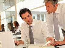 Manager ans salesman in office Royalty Free Stock Image