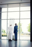 Manager with Arabian partner look outdoor Royalty Free Stock Images