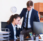 Manager arguing with subordinate official. Dissatisfied manager arguing with young subordinate official in office Royalty Free Stock Images