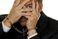 Manager arrested. Manager for Economic crime arrested and handcuffed Royalty Free Stock Image