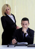Manager and assistant. Young manager checking the tasks with his blond secretary or assistant stock photos