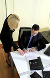 Manager and assistant. Young menager checking the tasks with his blond secretary or assistant Stock Image