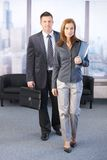 Manager and assistant going to business meeting. Smiling Royalty Free Stock Photos
