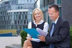 Manager and assistant talking about. Contract outside the office Stock Photography