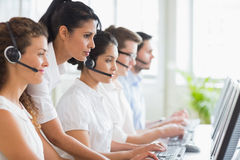 Manager assisting her staffs in call center Royalty Free Stock Image