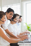 Manager assisting staffs in call center Stock Images