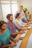 Manager assisting staffs in call center Royalty Free Stock Photography