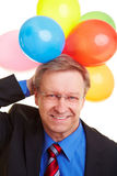 Manager with balloons behind his Stock Image