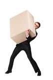 Manager bears a huge box. Manager in suit bears a huge cardboard box, isolated on white Royalty Free Stock Photo