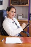 Manager. Beautiful young businesswoman in the office Stock Images