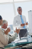 Manager is being applauded by colleagues Stock Photo