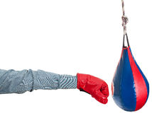 Manager with boxing glove punches punching bag Royalty Free Stock Images