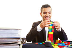Manager building a tower Stock Photos