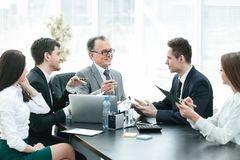 Manager and business group discussing financial documents stock photography