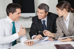 Manager in business meeting holding Stock Photography