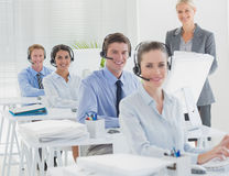 Manager and business team smiling at camera Stock Images