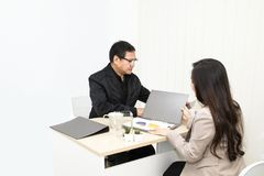 Manager businessman talking with businesswoman on office. royalty free stock image