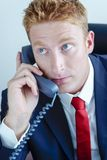 Manager Businessman talking over phone. Manager - Businessman talking over phone expressing emotions Stock Photo