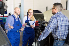 Manager calculating car repair cost Royalty Free Stock Images