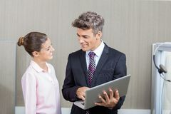 Manager And Call Center Employee Using Laptop Stock Photography